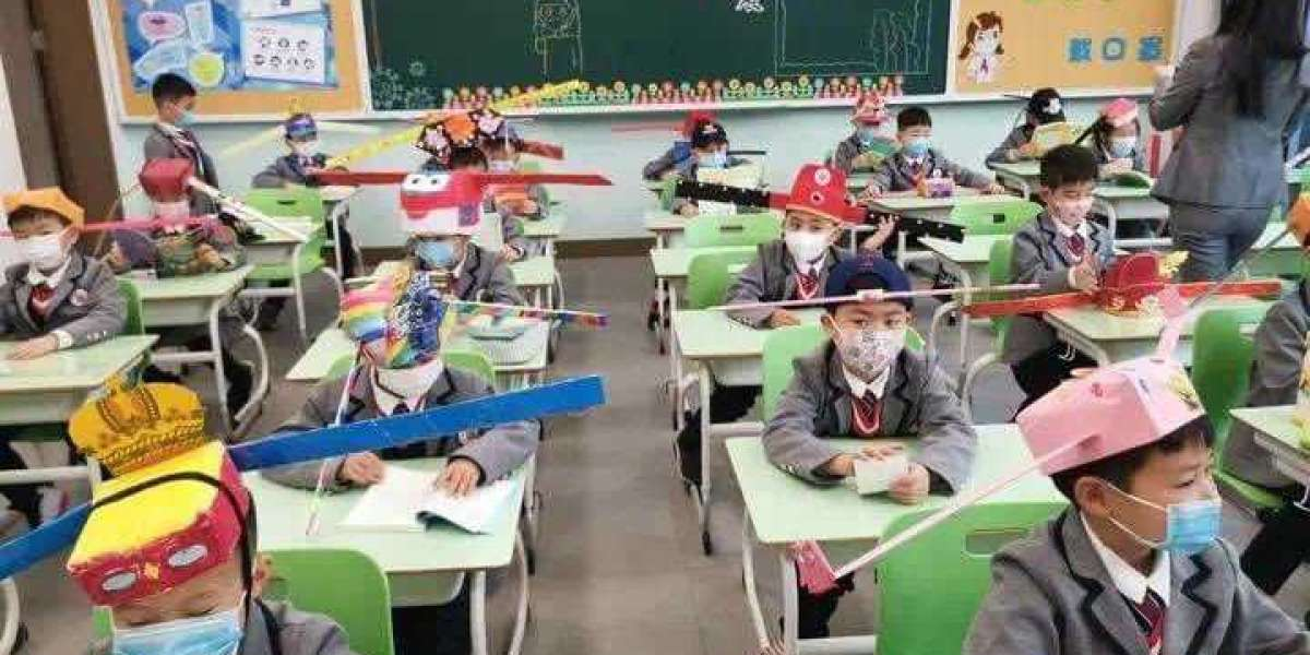 Students wear social distancing headgears to class as schools resume in China